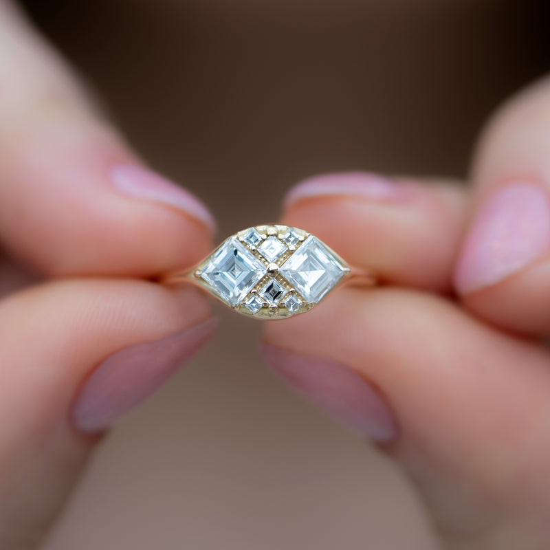 Step-Cut-Engagement-Ring-with-Eight-Square-Diamonds-top-shot