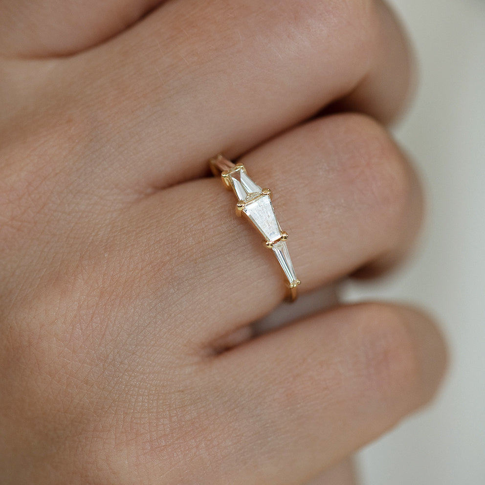 Tapered Baguette Engagement Ring on Hand Up Close Shot