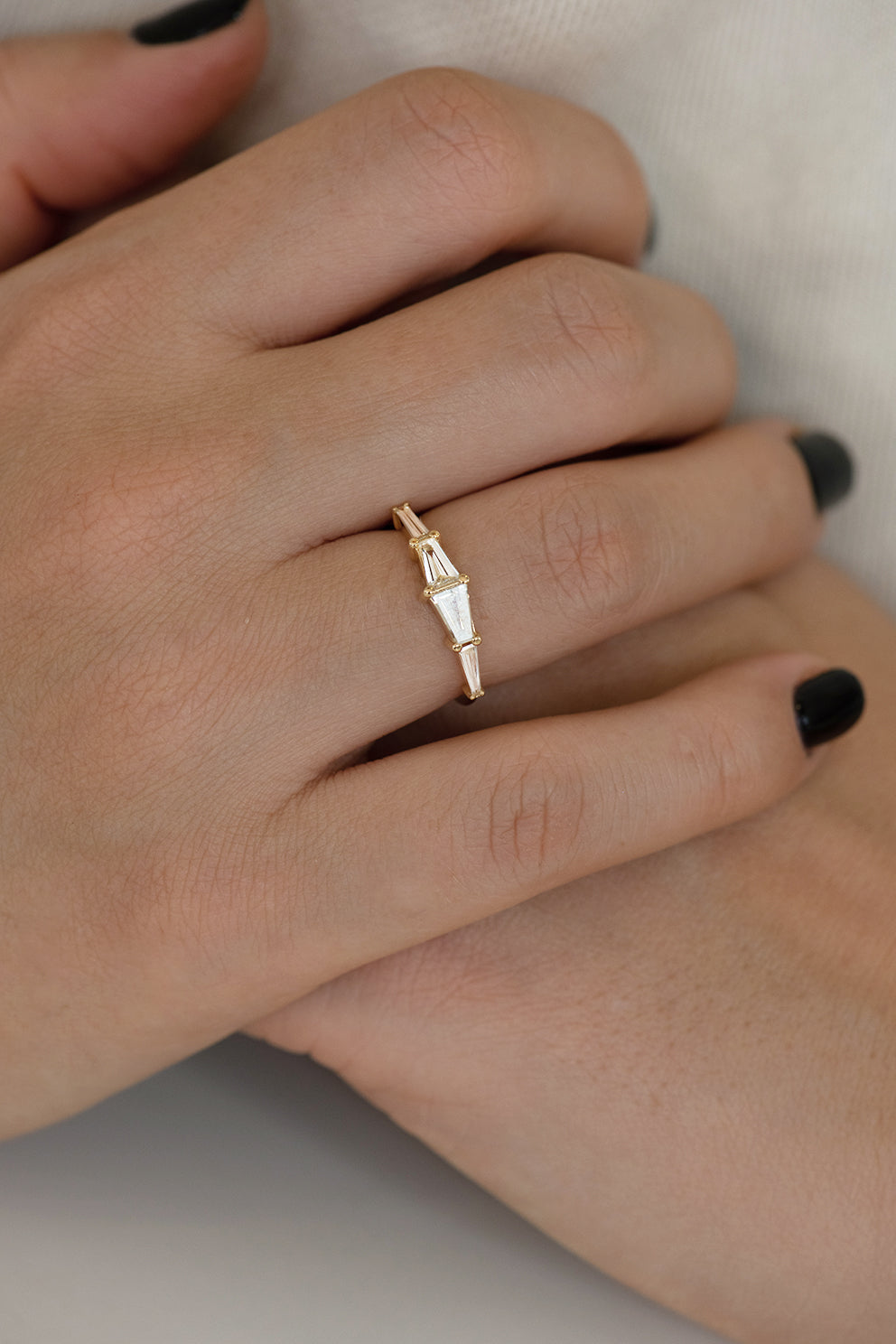 Tapered Baguette Engagement Ring on Hand