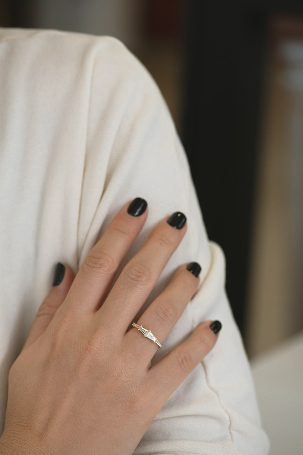 Tapered Baguette Engagement Ring on Hands with Shoulder