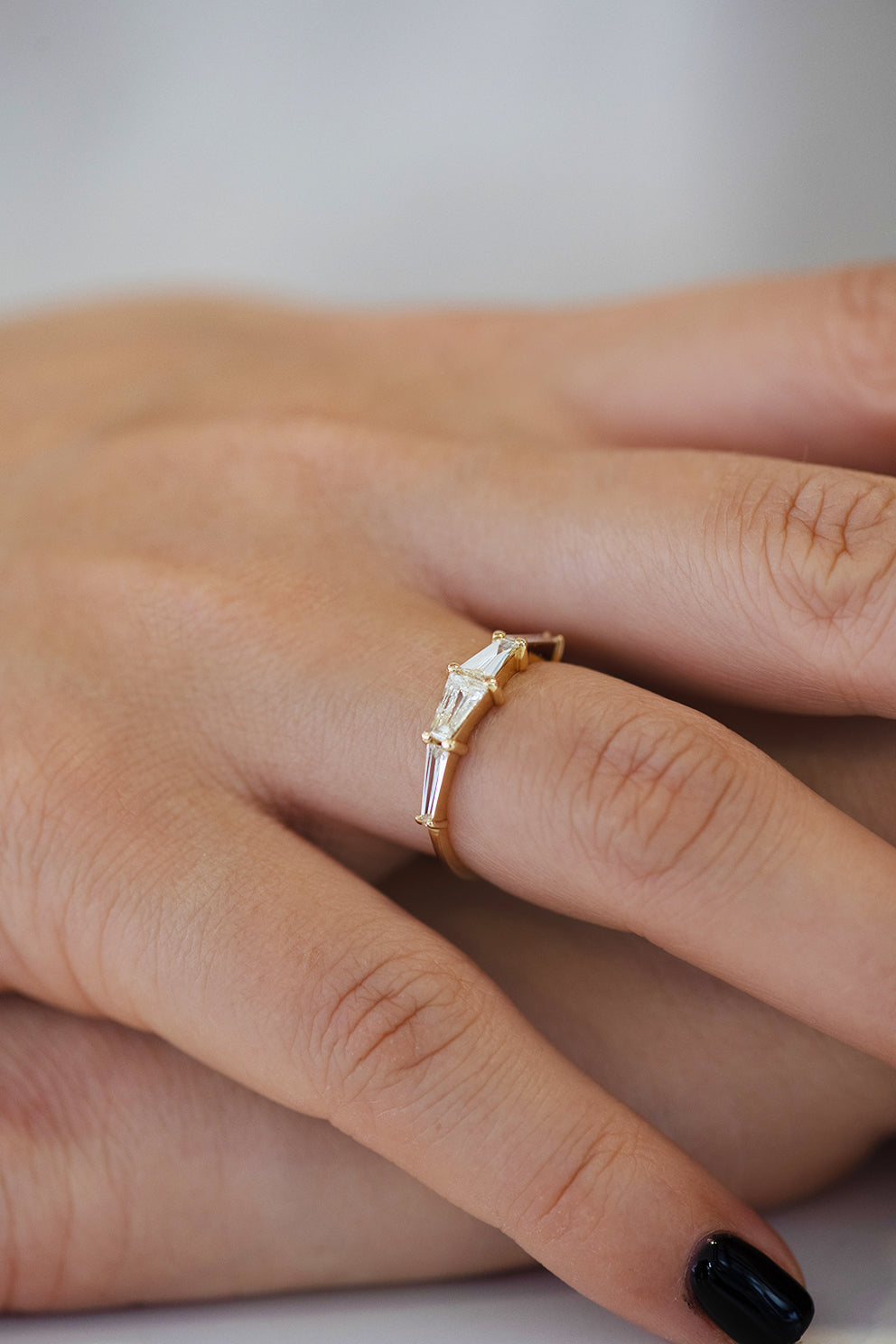 Tapered Baguette Engagement Ring on Hand Side View