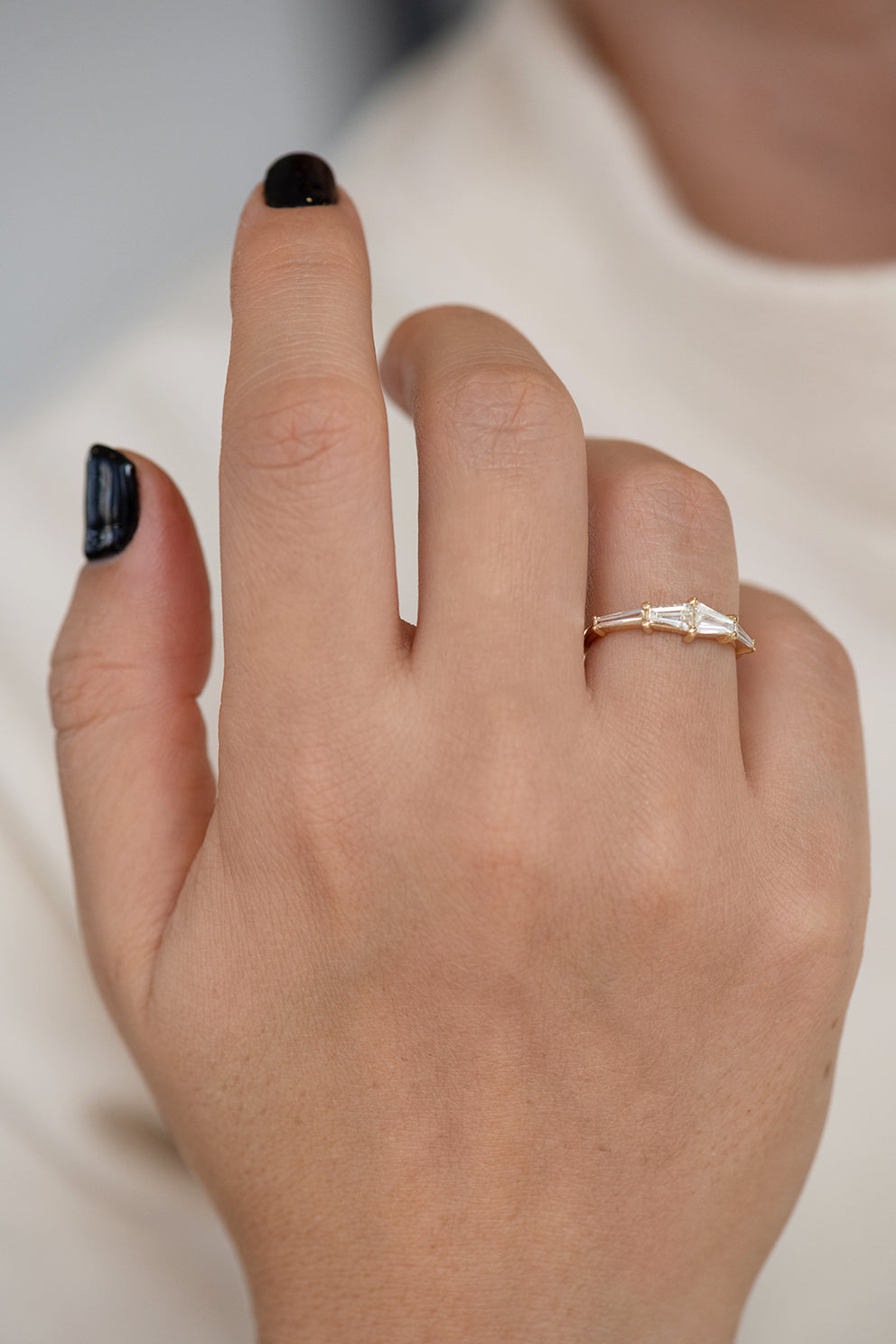 Tapered Baguette Engagement Ring on Hand Lower Angle Frontal Shot