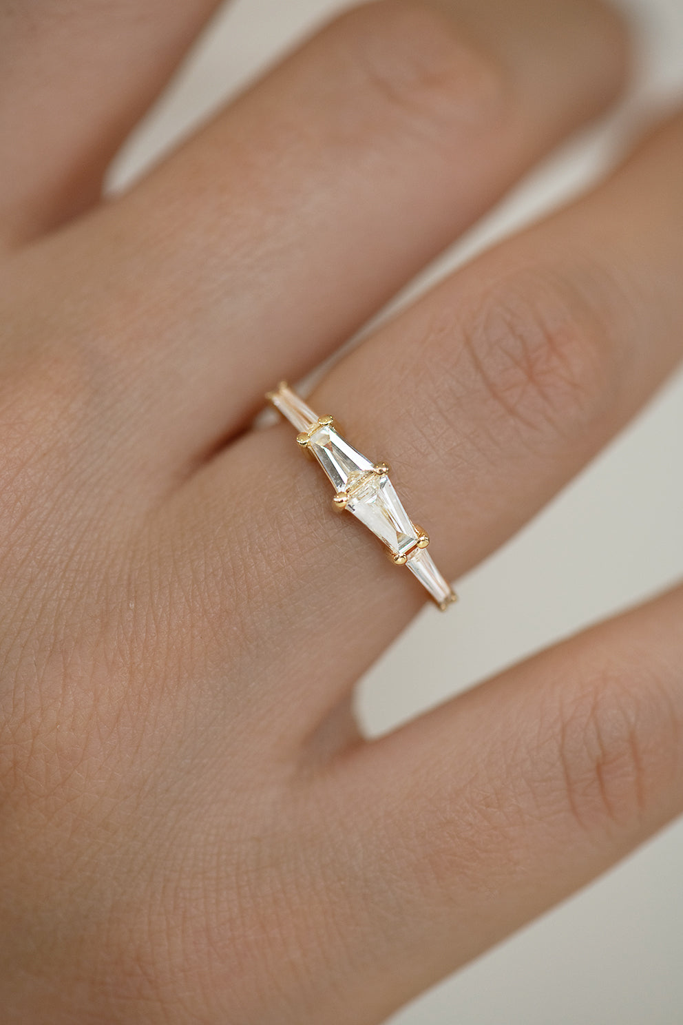 Tapered Baguette Engagement Ring Up Close View on Finger