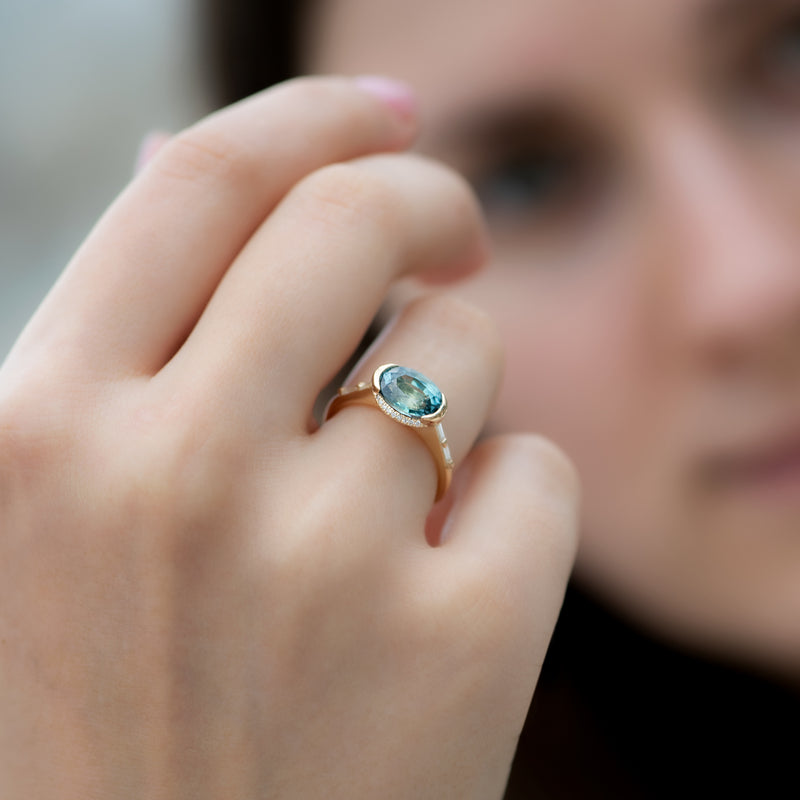 Teal-Sapphire-Engagement-Ring-with-Delicate-Diamond-Detailing-OOAK-on-finger