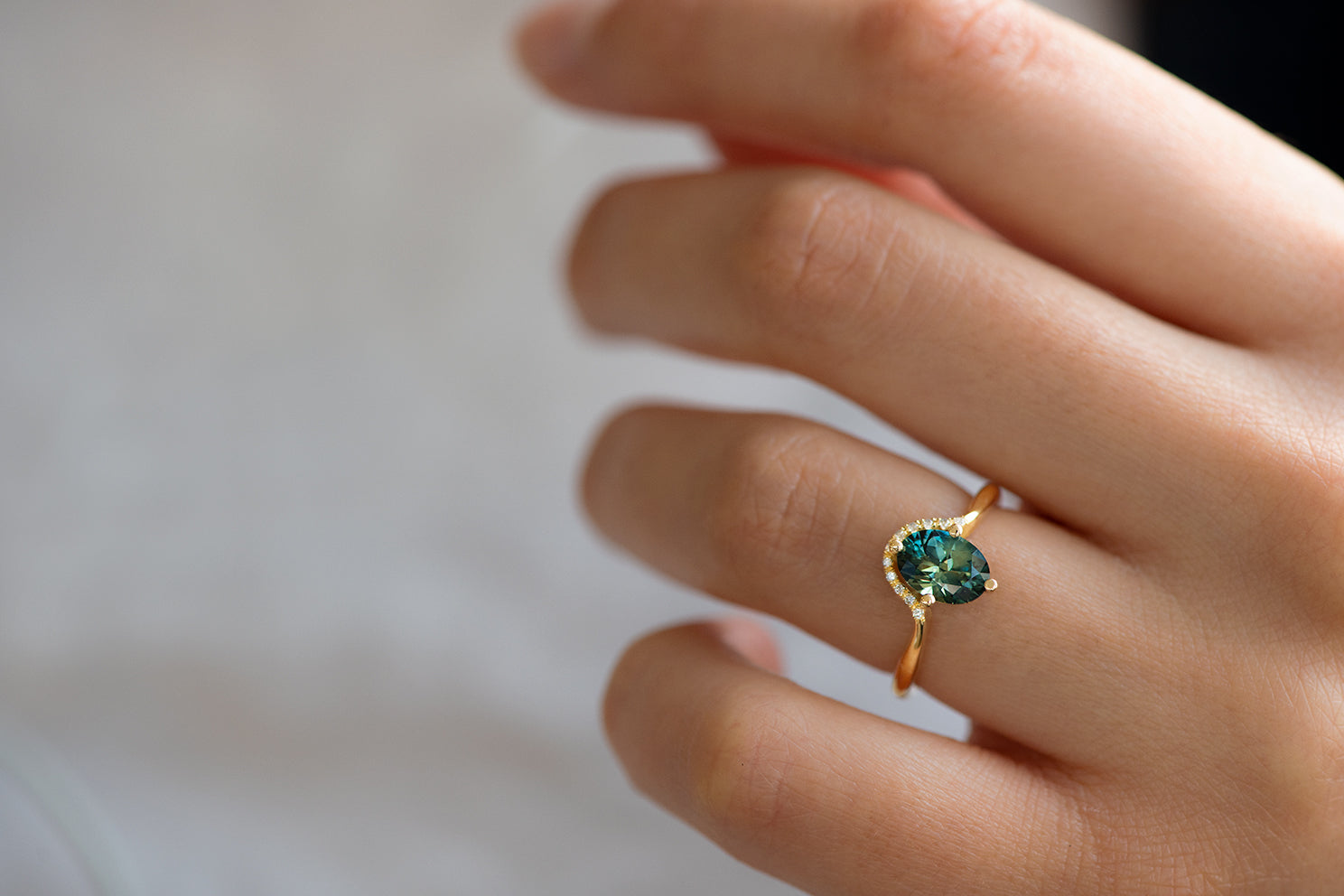 Teal Sapphire Engagement Ring - OOAK on Hand Up Close in Shadow