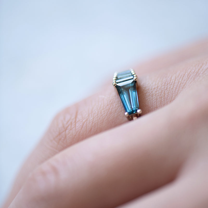 Teal Sapphire Gradient Engagement Ring Hand on WhiteSide Close.jpg