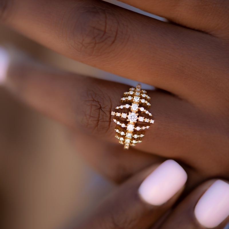 The-Gold-Nova-Ring-with-Garlands-of-Gradient-Diamonds-TOP-SHOT-ON-FINGER