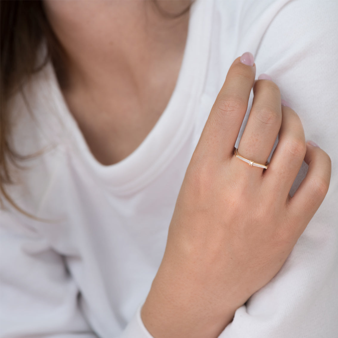 Thin-Tapered-Baguette-Cluster-Ring-Alternative-Wedding-Ring-on-finger
