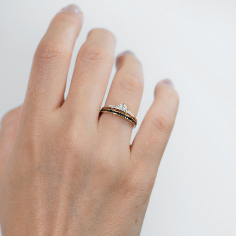 Three-Stone-Engagement-Ring-with-Half-Moon-and-Baguette-Cut-Diamonds-in-set-on-finger