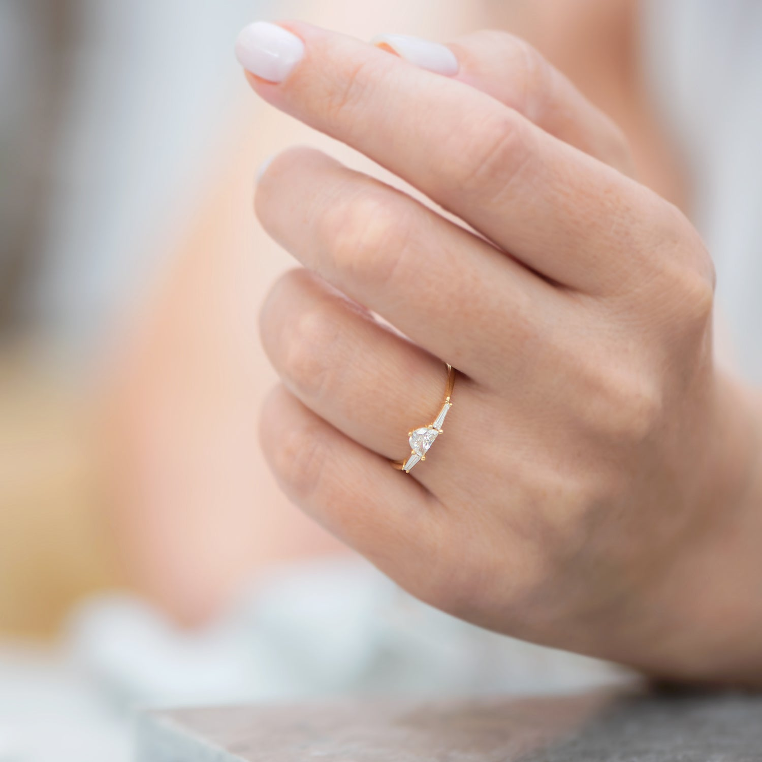 Three-Stone-Engagement-Ring-with-Half-Moon-and-Baguette-Cut-Diamonds-on-hand
