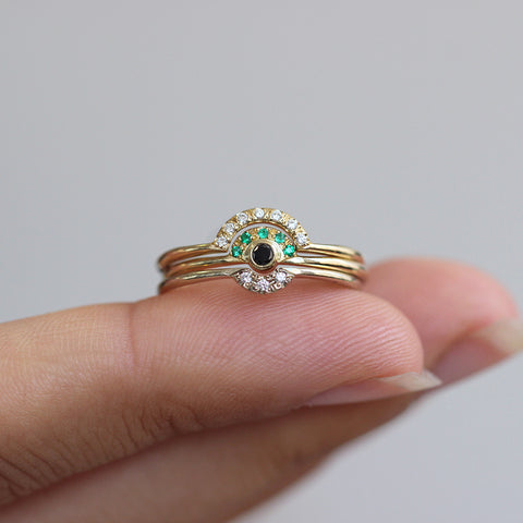 Tiny Black Diamond Engagement Ring Crowned With Pave Emeralds In Hand