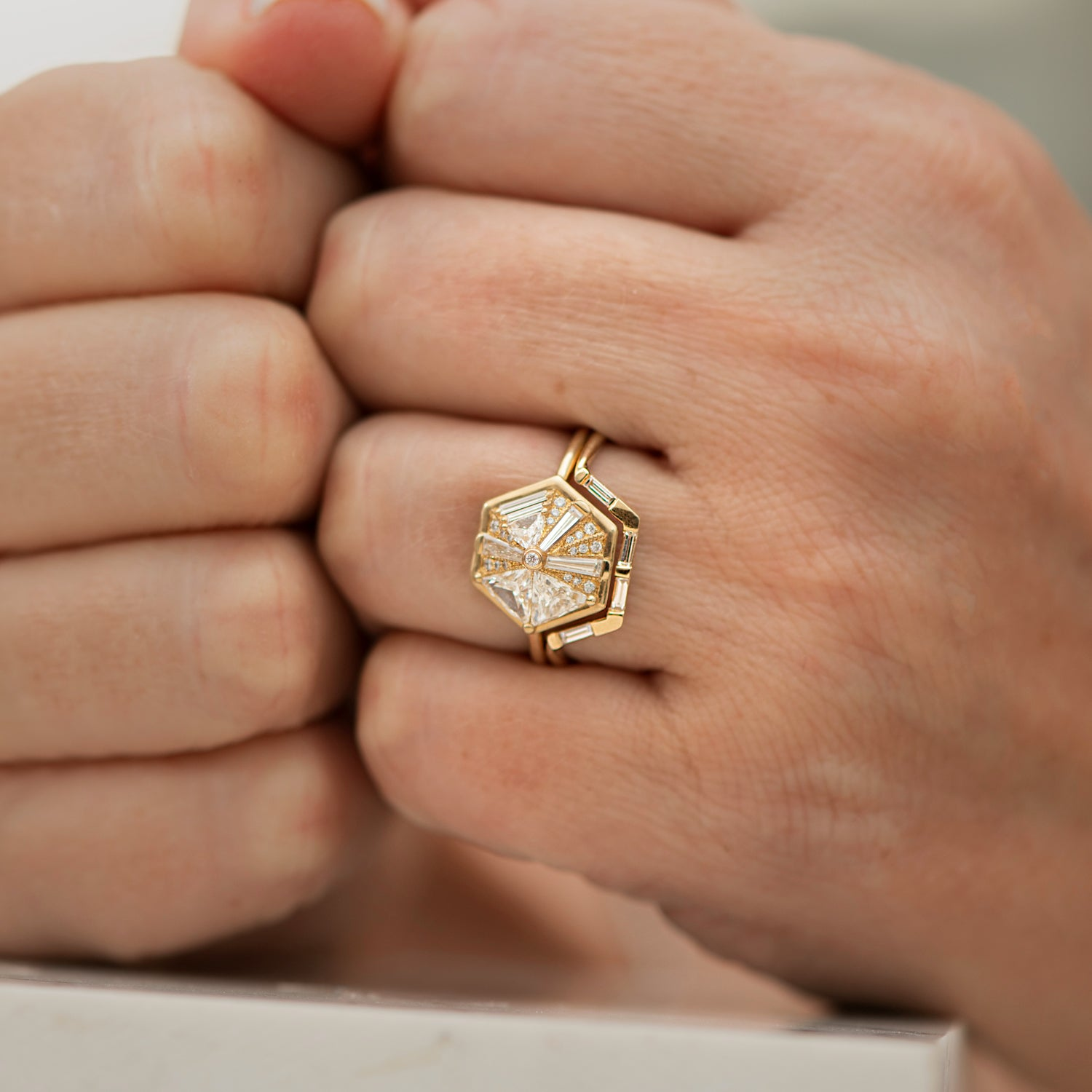 Trapezoid-Nesting-Ring-with-Baguette-Diamonds-closeup-on-hand