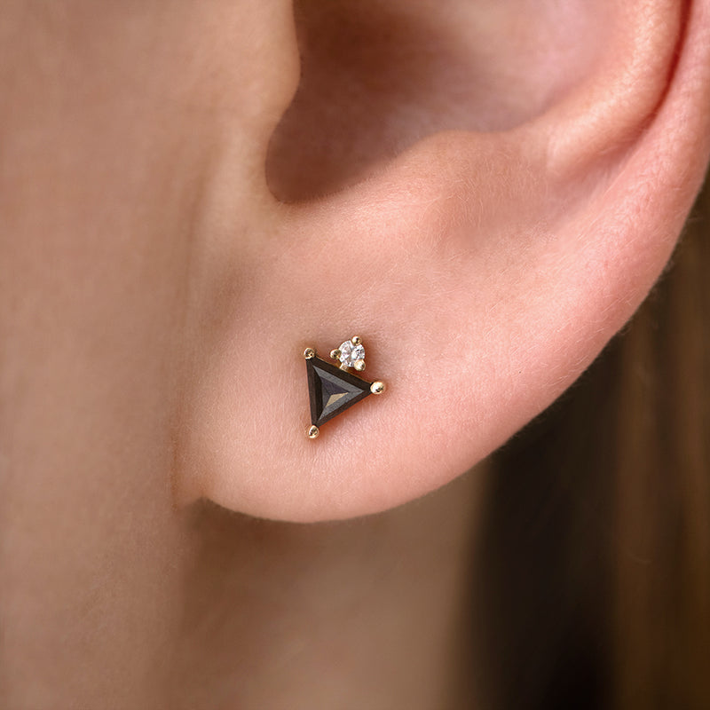 Triangle Earrings with Black and White Diamonds on ear up close