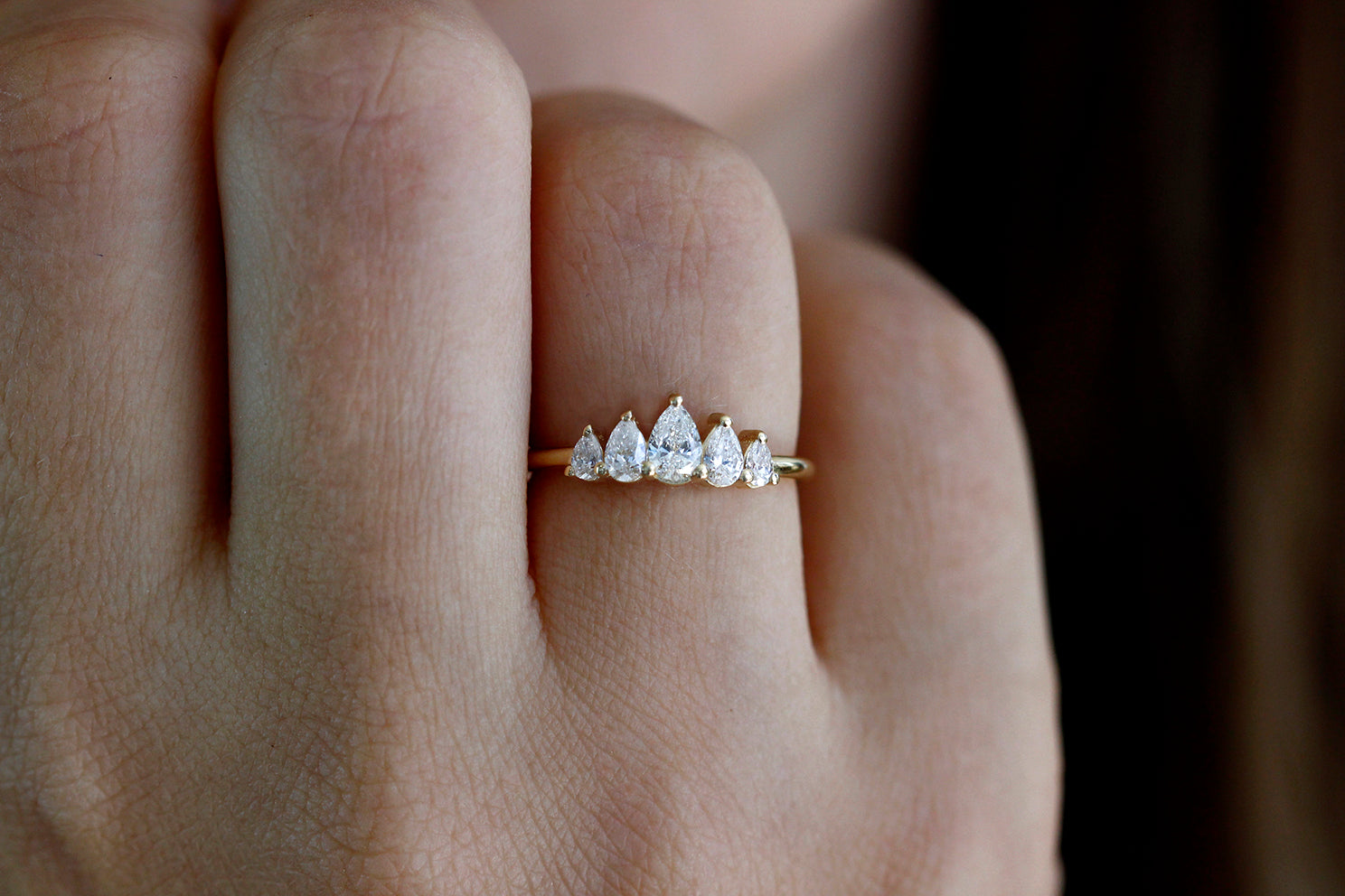 Unique Pear Diamond Engagement Ring On Finger