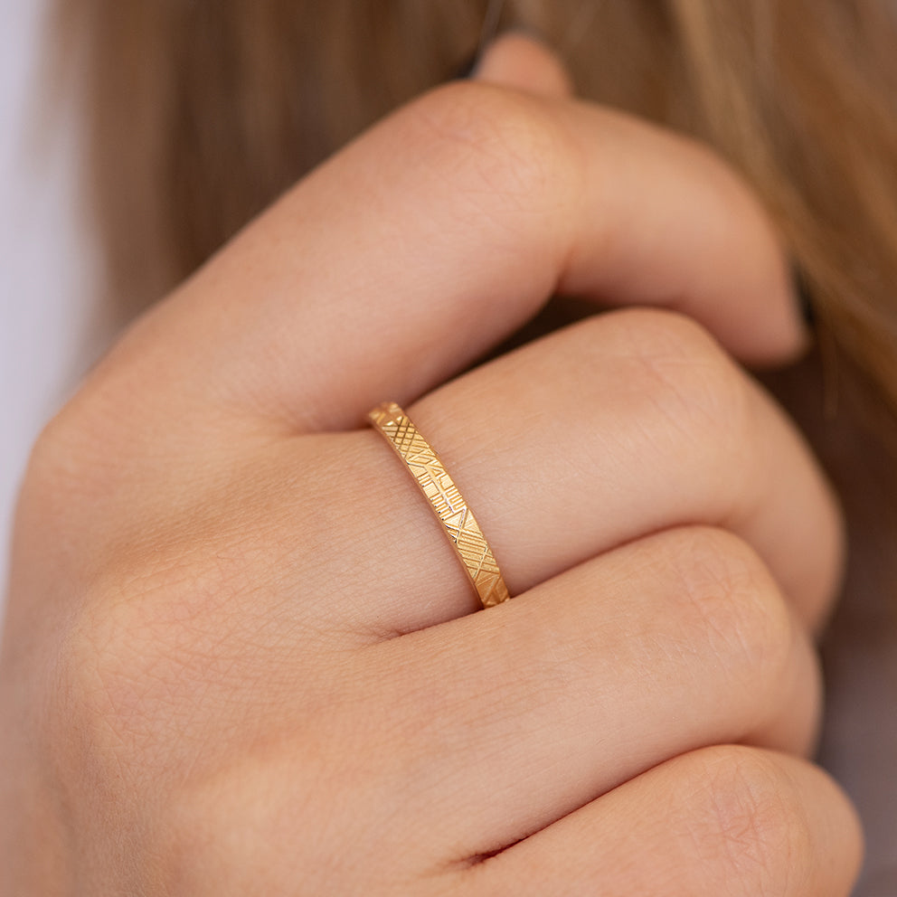 Unique Geometric Wedding Ring on Hand Detail Shot