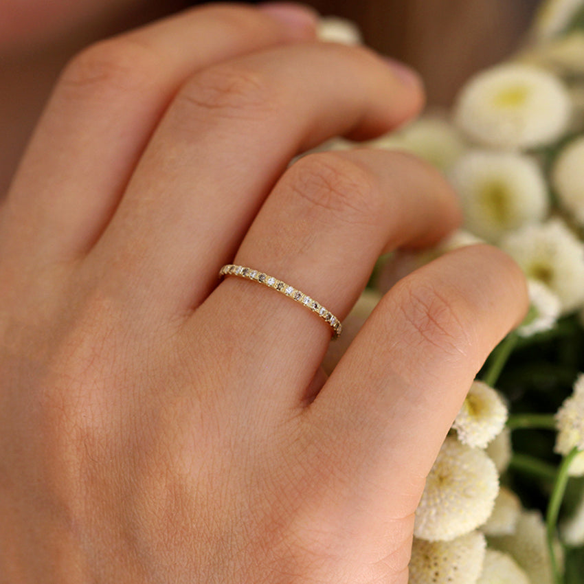 White And Champagne Diamond Eternity Wedding Band On Finger