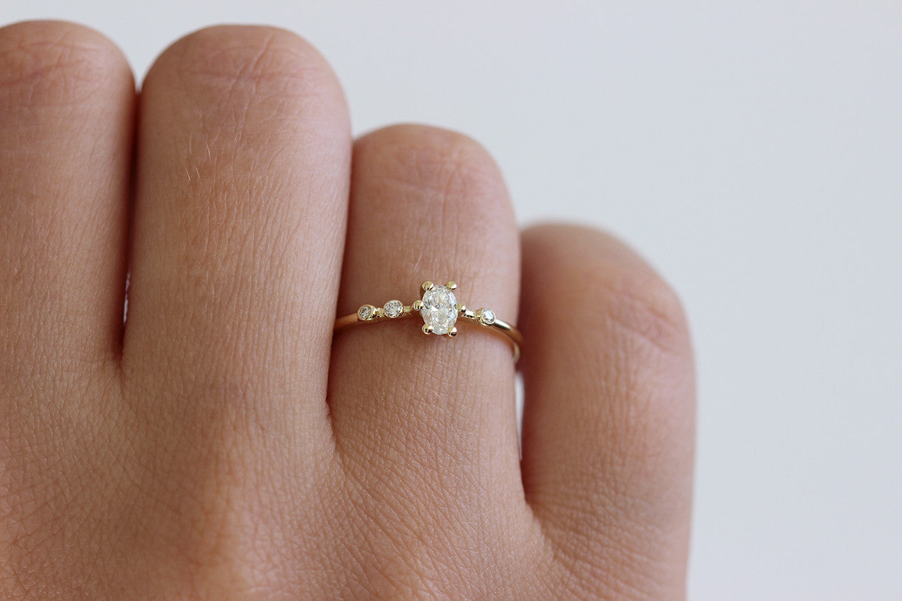 0.2 carat diamond ring on finger