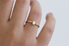 oval engagement ring on finger