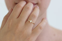 delicate asymmetric engagement ring