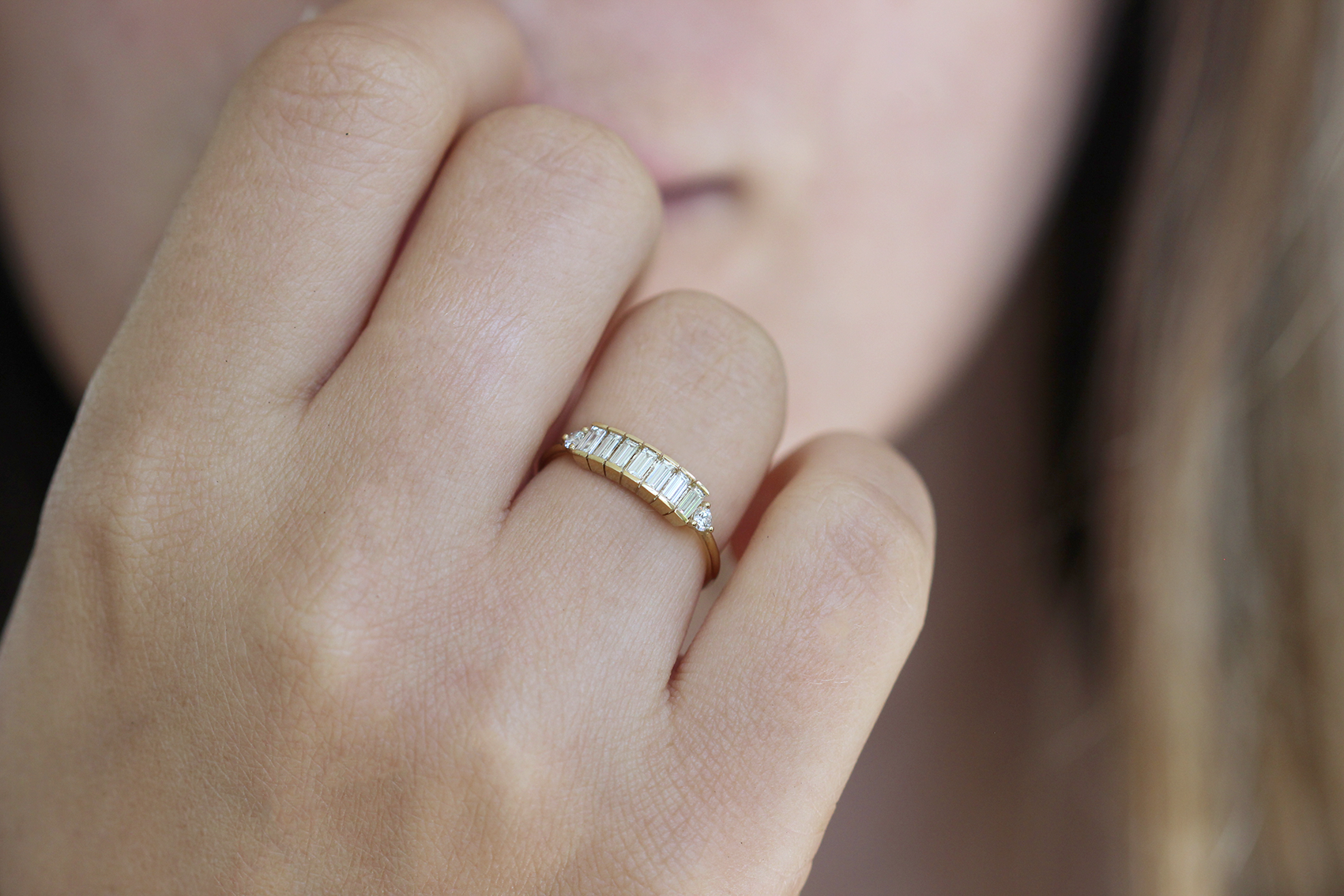 Dainty Baguette Engagement Ring on finger