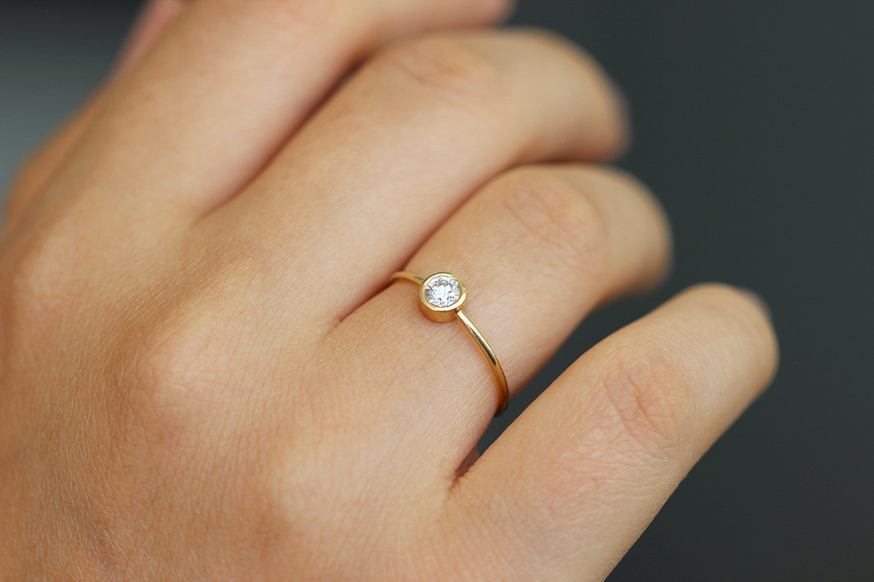 Simple engagement ring on hand