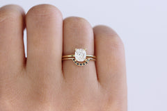 0.8 carat engagement ring on finger