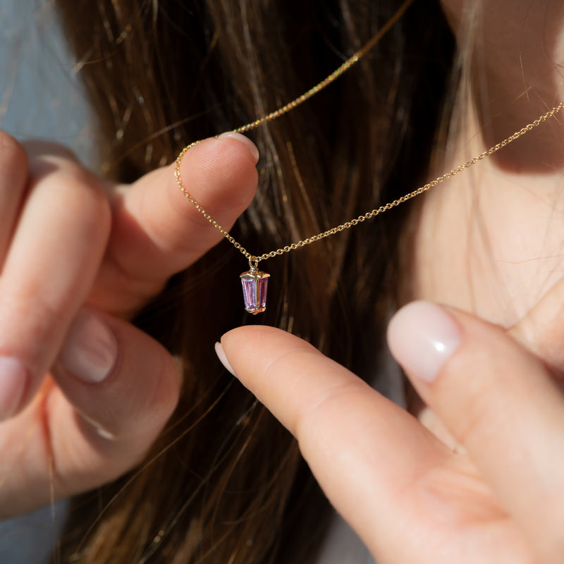 dainty-lilac-sapphire-lantern-pendant-in-solid-gold-on-finger