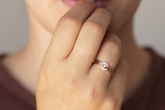 Dainty Gold Wedding Band on finger