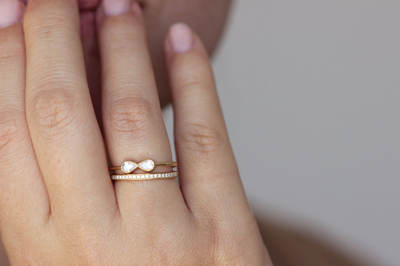 Thin classic diamond eternity ring in 18k solid gold on hand
