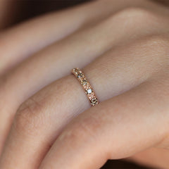 eternity ring with champagne diamonds on hand