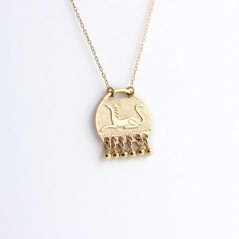 Collier d'animal mythique d'or