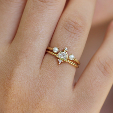 Delicate cluster engagement ring set with half moon diamond and pearls