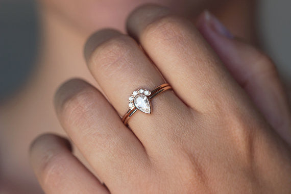 Pear diamond wedding set on hand