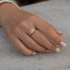 classic Emerald-cut engagement ring with tapered needle baguette diamonds3