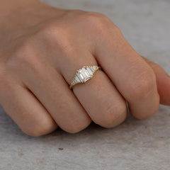 classic Emerald-cut engagement ring with tapered needle baguette diamonds6