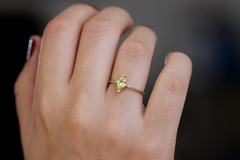 unique yellow sapphire in an elegant marquise cut on hand