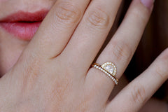 Dainty wedding ring with a tall front on hand