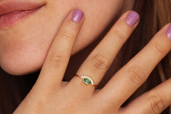 Emerald engagement ring on hand