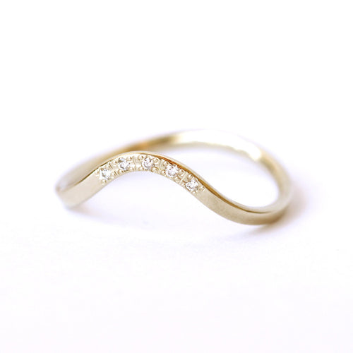 curved wedding ring with diamonds