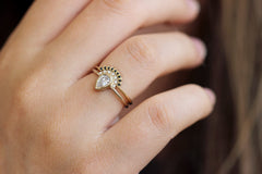 Pear Diamond Wedding Ring on finger