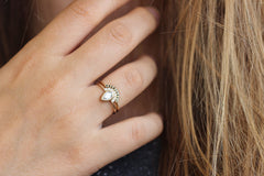 0.3 carat pear engagement ring on finger