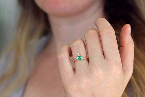 Pear Emerald Ring on finger