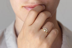 pearl engagement ring with diamonds on hand