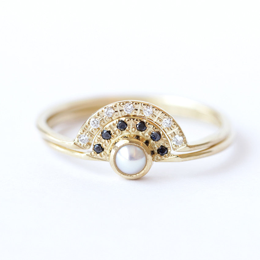 pearl engagement ring with black diamonds