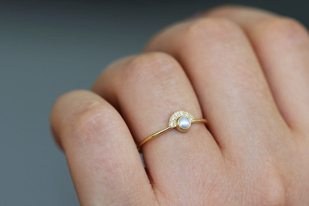 Pearl engagement ring on finger