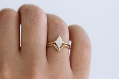 Rhombus diamond ring on hand