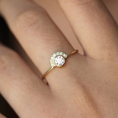 Diamond engagement ring in 18k solid gold on finger