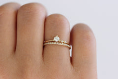 engagement ring set on hand
