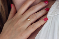 delicate engagement ring on hand