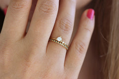 delicate engagement ring set on hand